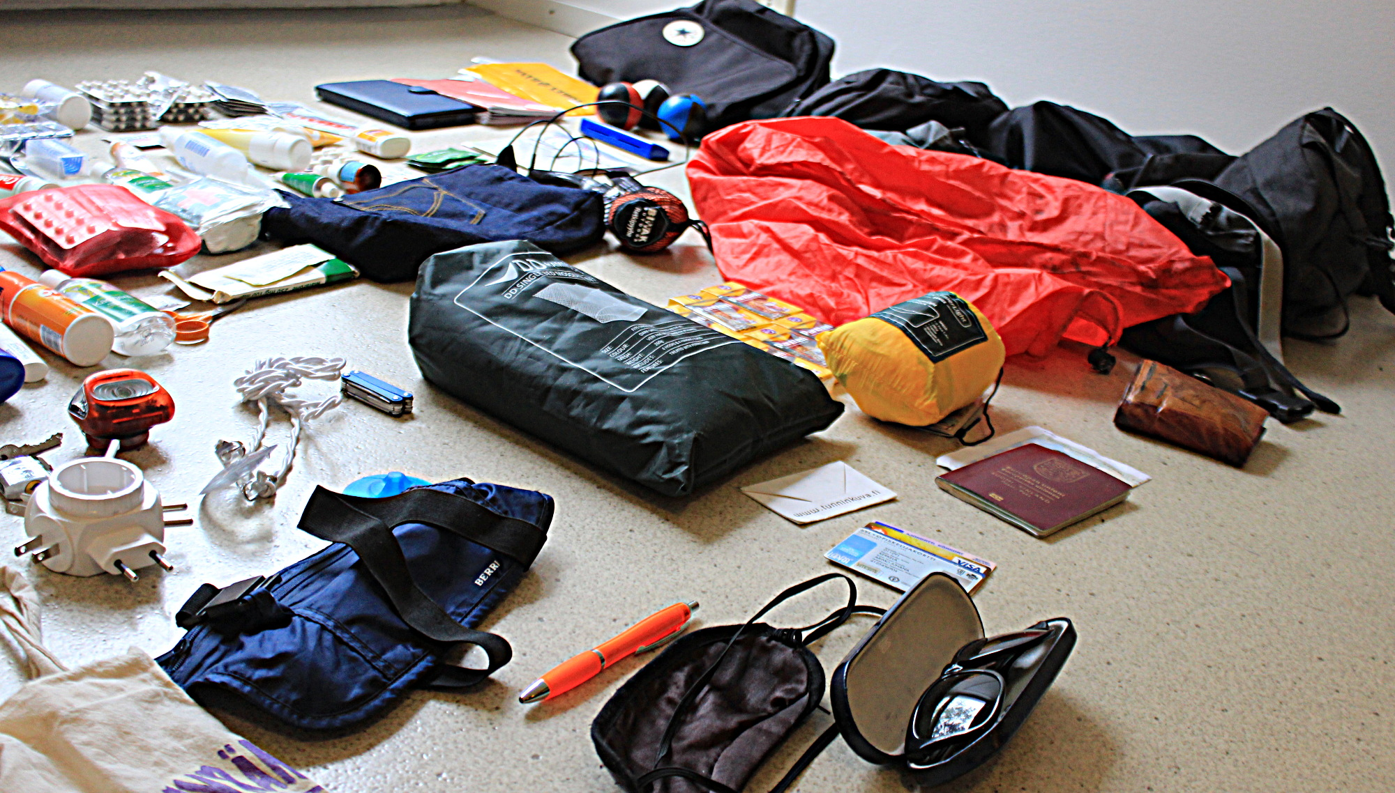 Travel equipment spread to cover the floor.