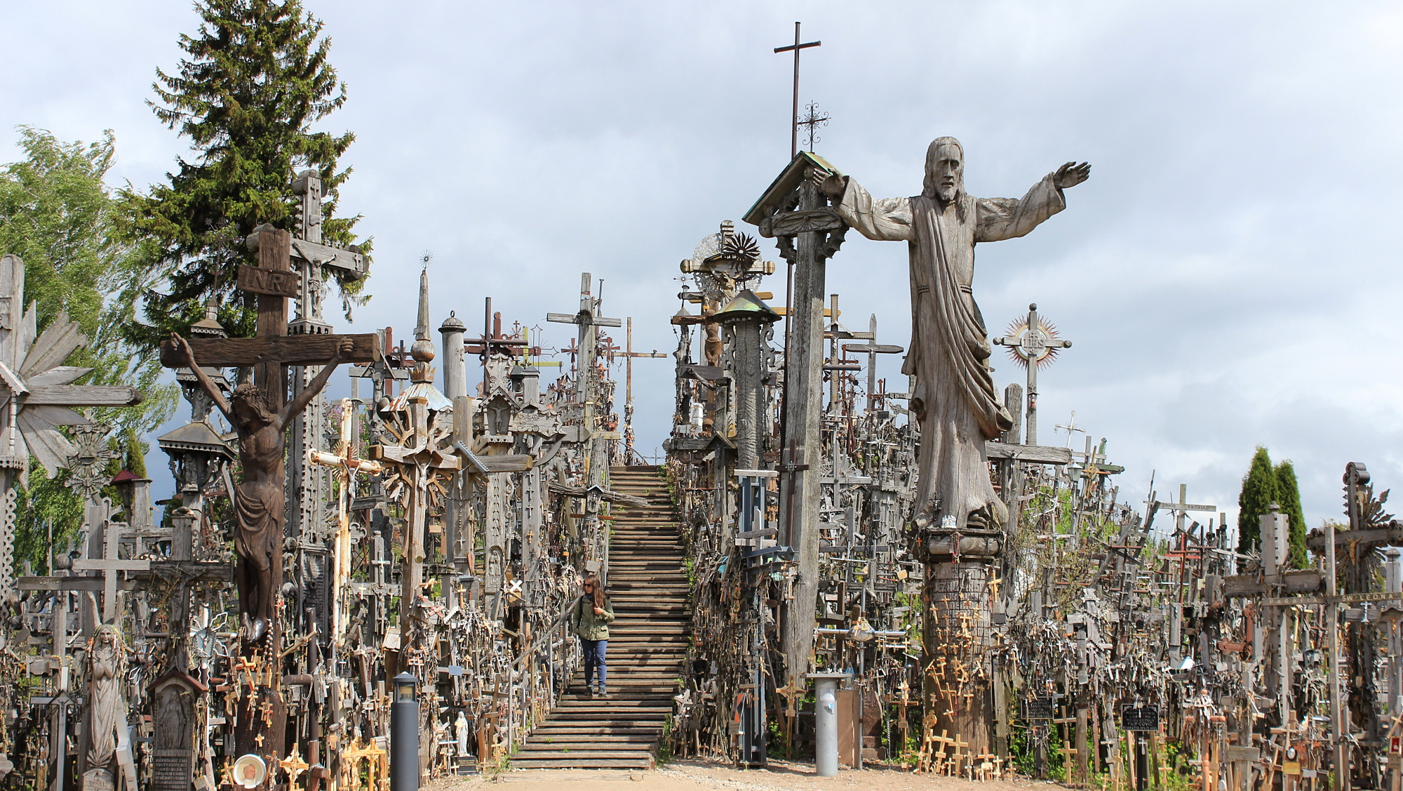 Thousands of crosses on a hill with a stairway in the middle.
