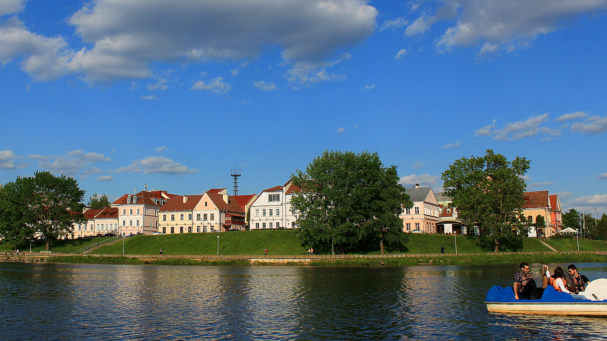 Troitskoye Predmestie or the Trinity Suburb is the old town of Minsk. Pictured on a beautiful sunny day with the river in front. Hostel Trinity is one of the few hostels for backpacking in Belarus.