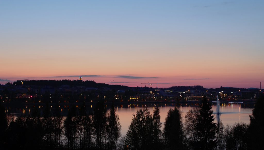 The center of Jyväskylä at night from the other side of Lake Jyväsjärvi.