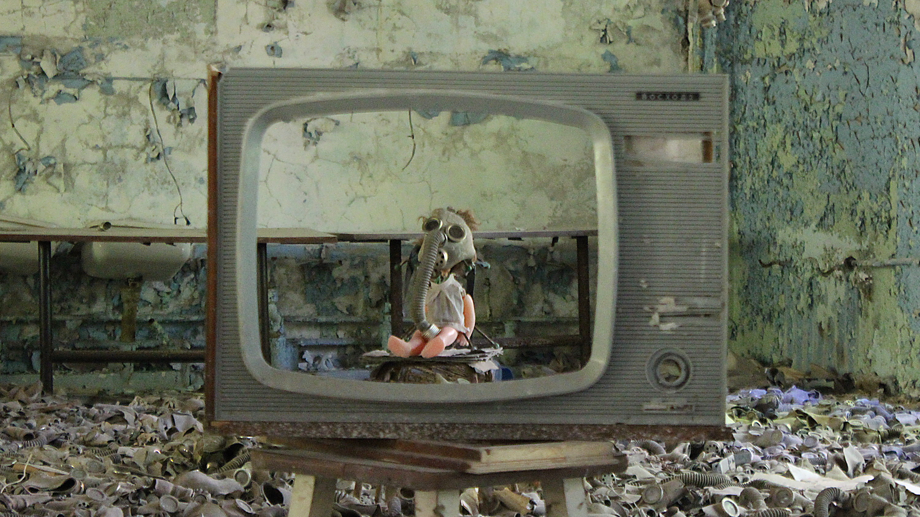 A creepy baby doll with a gas mask inside a television in Pripyat near Chernobyl.
