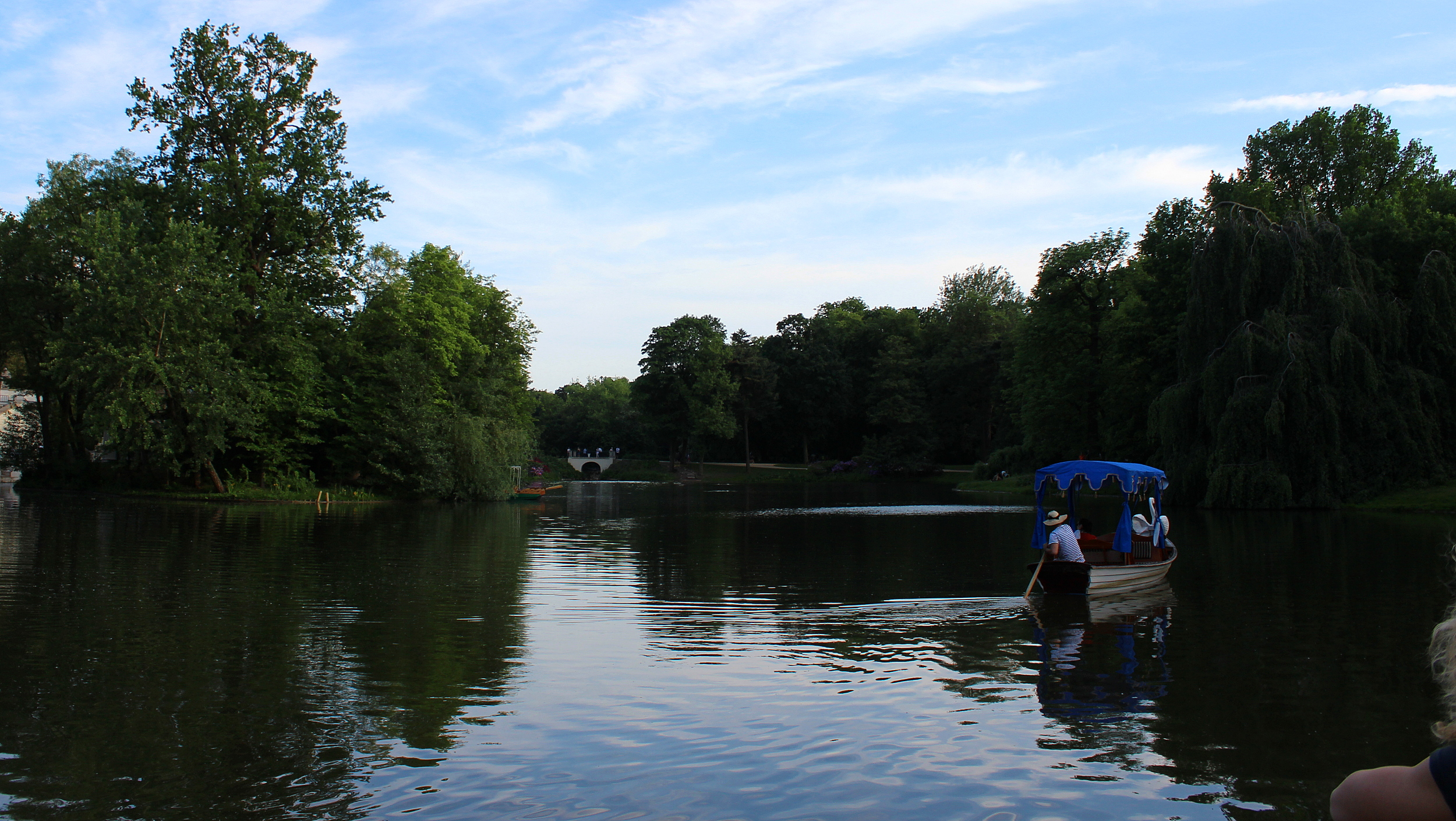 Visiting Poland for one week. Lazienki Park (Royal Baths Park) in Warsaw with a lake on a beautiful lake.