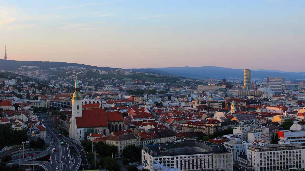 Reasons for traveling in Eastern and Central Europe. The Old Town of Bratislava, Slovakia at sunset from the UFO bridge tower.