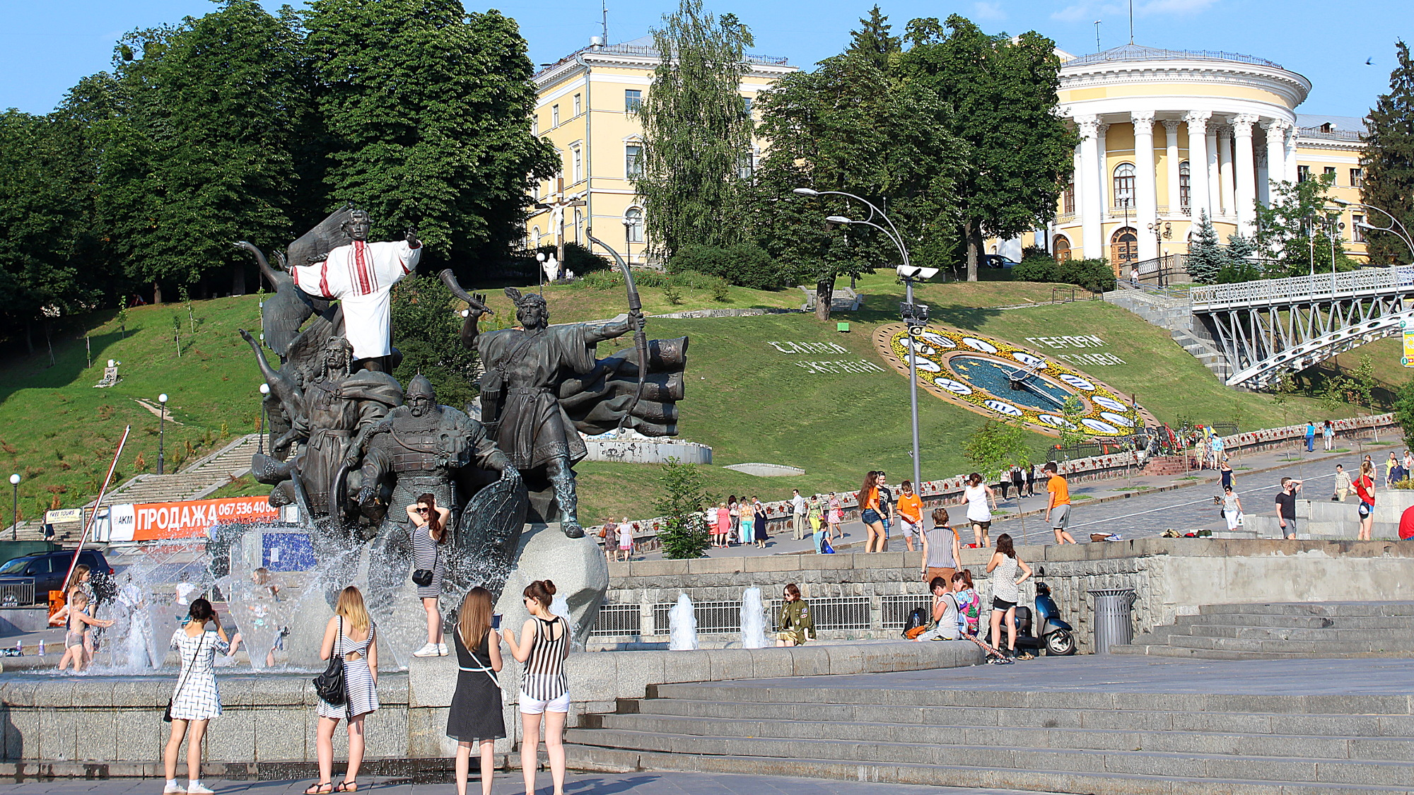 Beautiful girls in the Independence Square of Kiev in the summer.