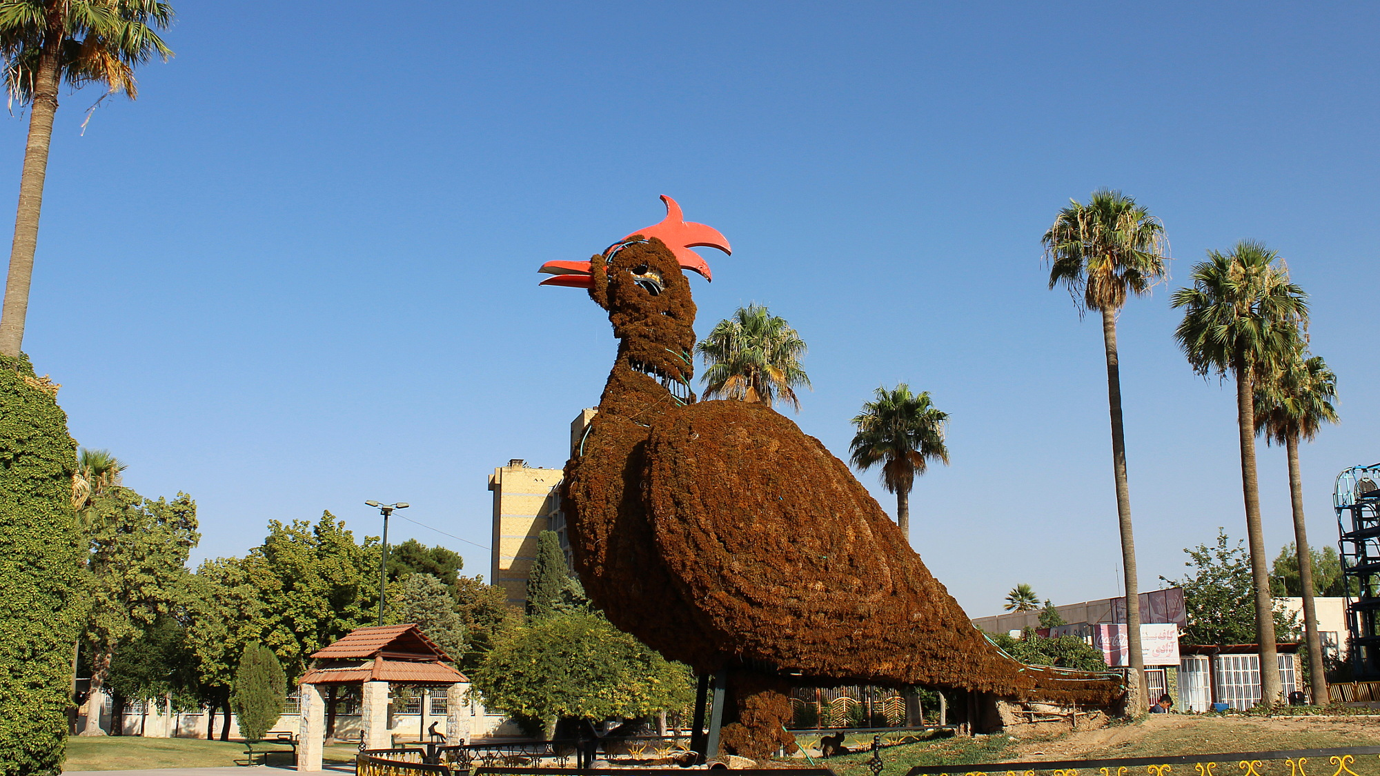 A giant chicken statue in a park in Shiraz.