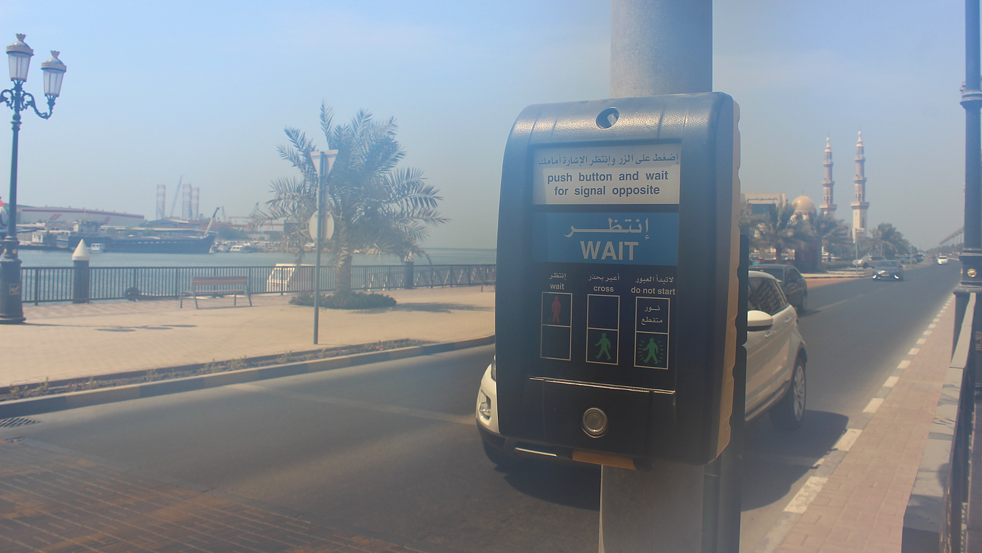 United Arab Emirates travel advice. Pedestrian traffic light instructions in a picture taken with a misty lens in the humidity of Dubai.