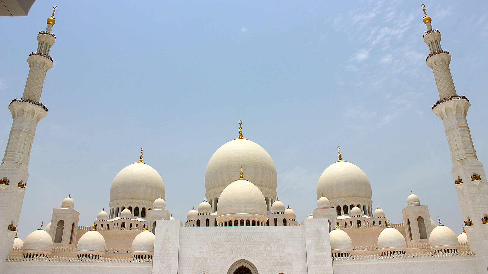 Front view of the Sheikh Zayed Mosque of Abu Dhabi in the summer.