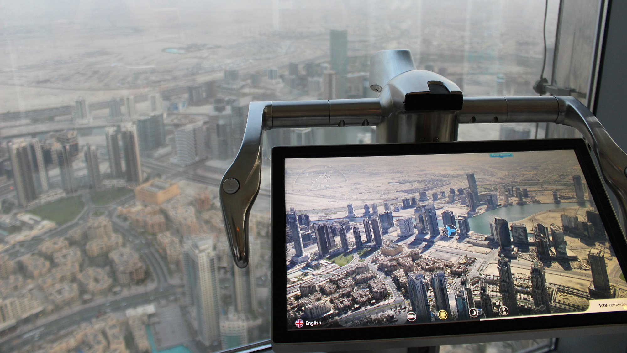 Burj Khalifa VR screen or digital binoculars showing Dubai on a clear day.