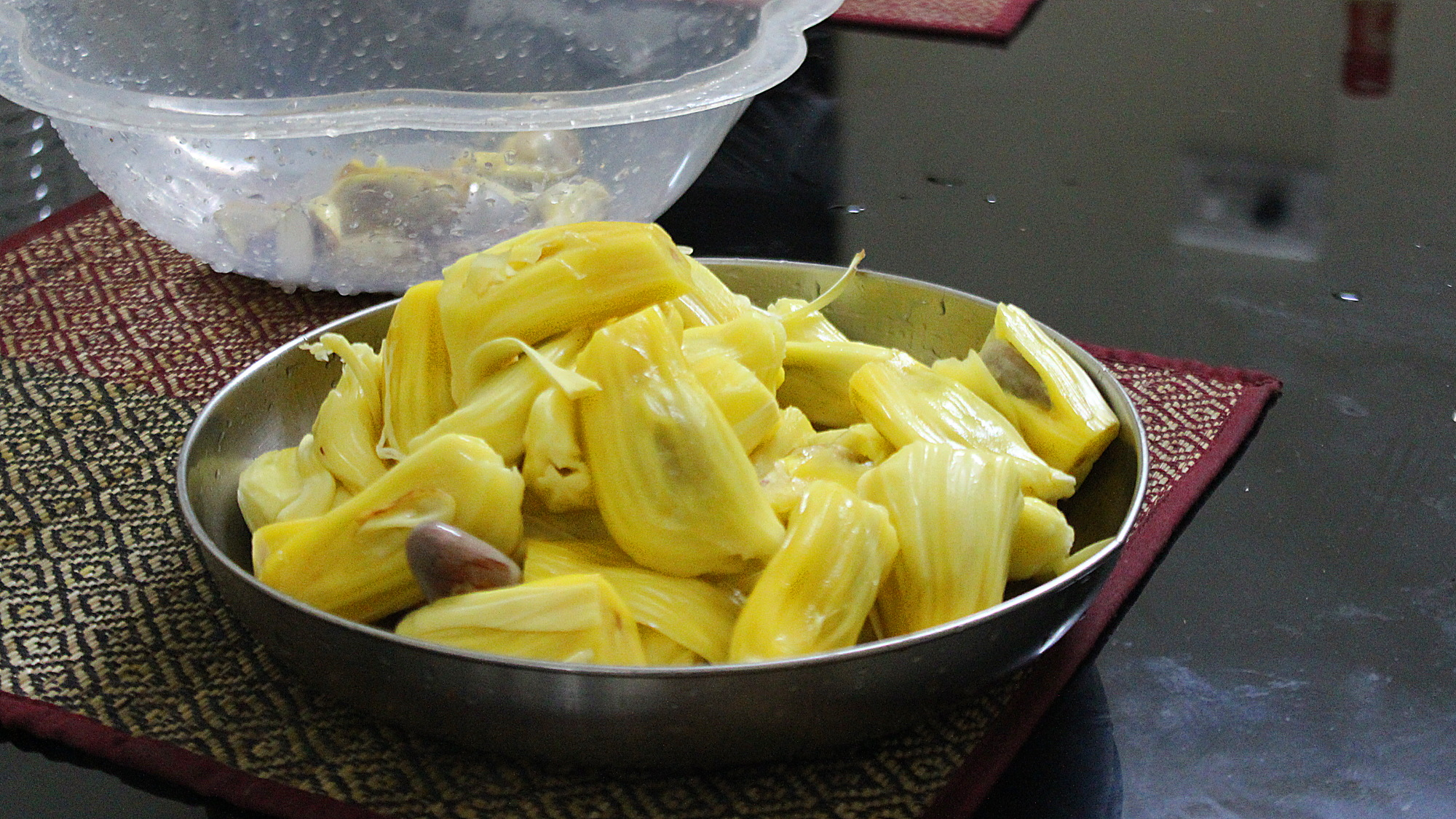 Peeled and cut jackfruit pieces on a metal plate.