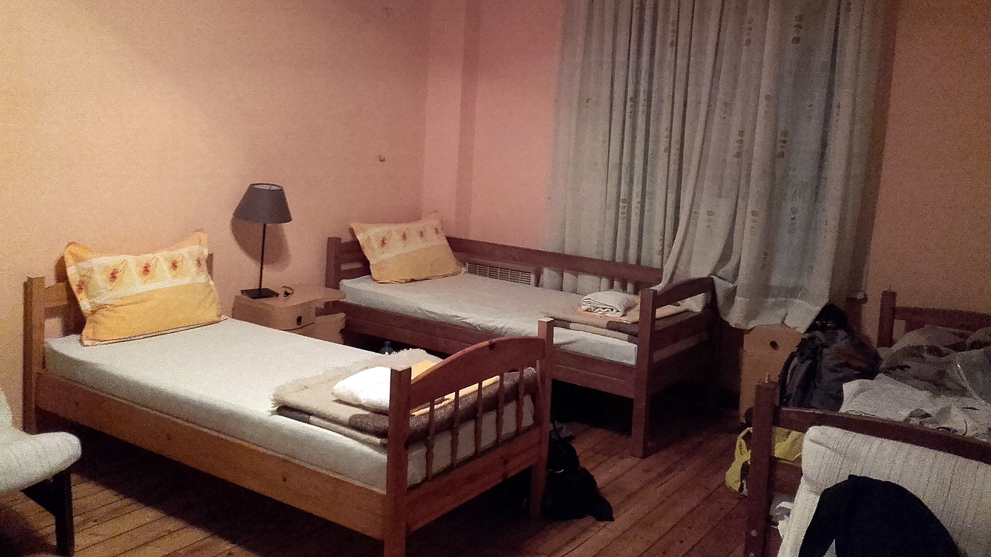 A dorm room in an old building with wooden beds in Sofia, Bulgaria.