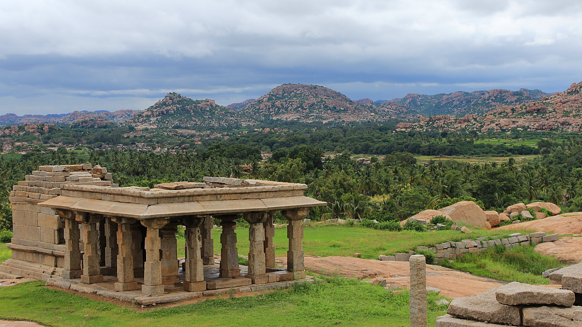 The ruins of Hampi are remnants of Vijayanagara, the capital of the historic Vijayanagara Empire. Here's a view from one hill to the nature around the town.