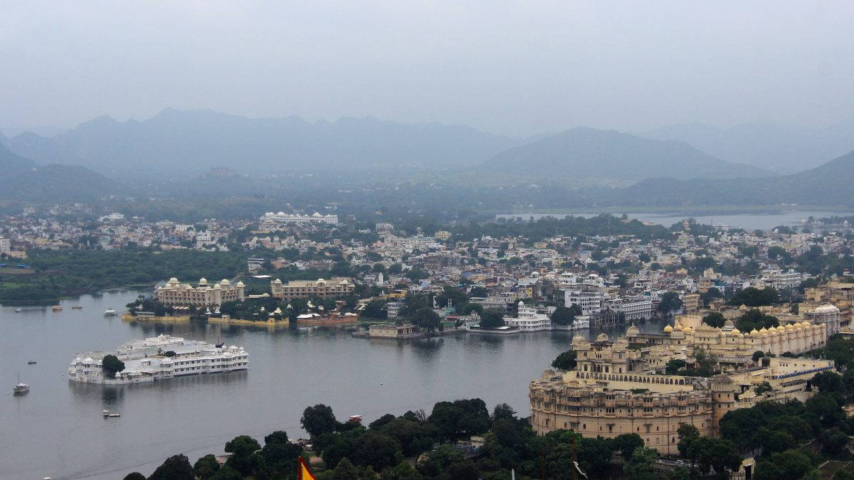 Udaipur and Lake Pichola photographed from lookout hill on a cloudy day.