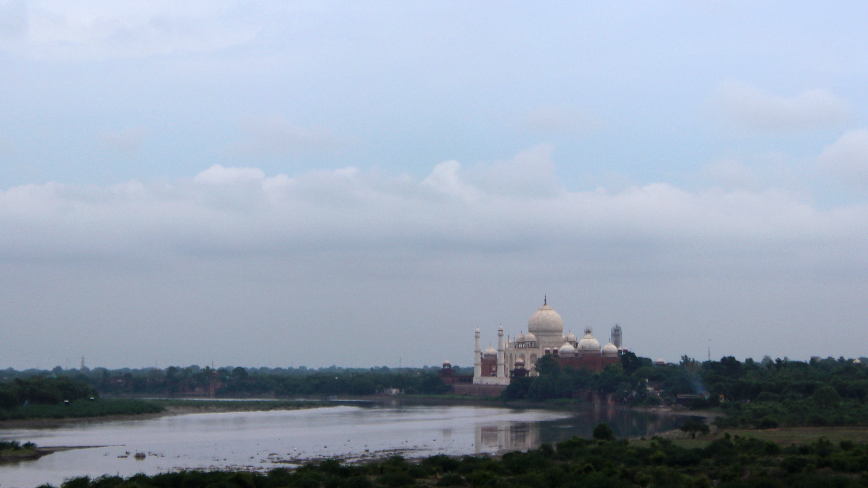 Taj Mahal as seen from the Agra Fort on a cloudy day.