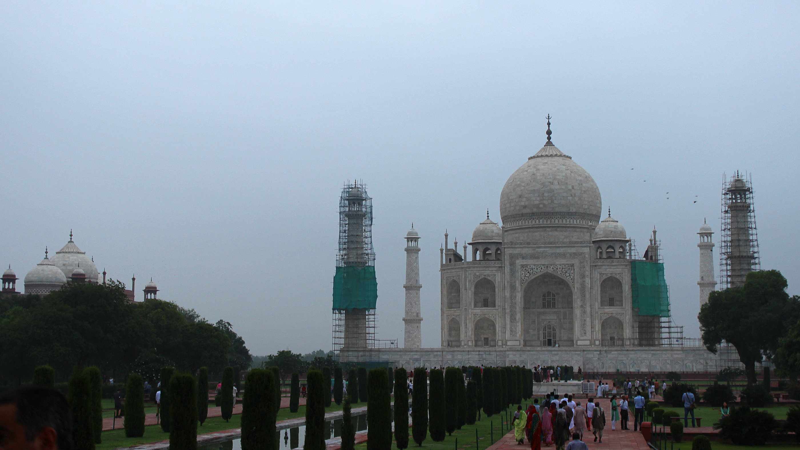 Alternative pictures of Taj Mahal: Here's the mausoleum on a cloudy morning with the front towers under renovation.