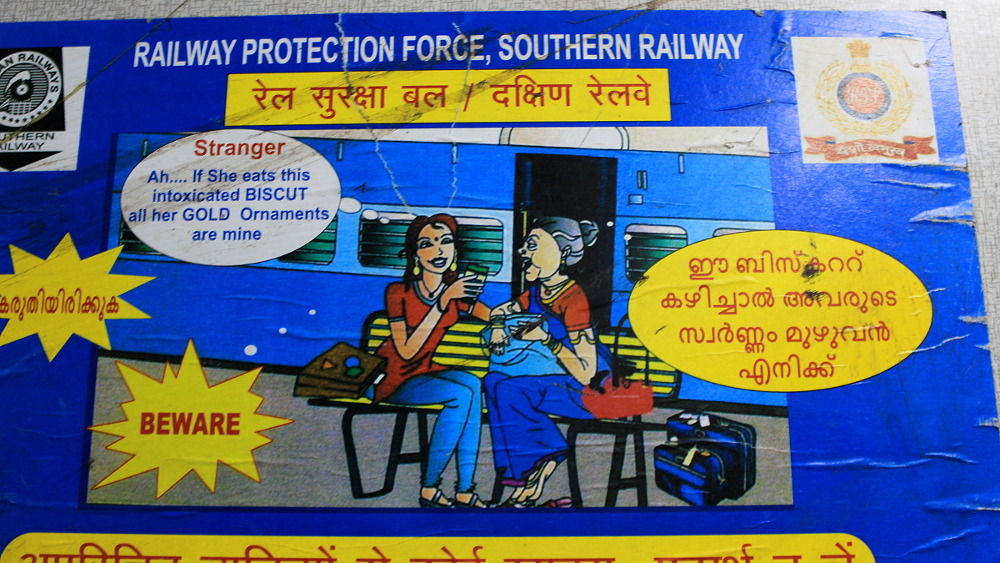 "Survival tips for India: an official sign warning about ""intoxicated BISCUTS"" on a train in India."