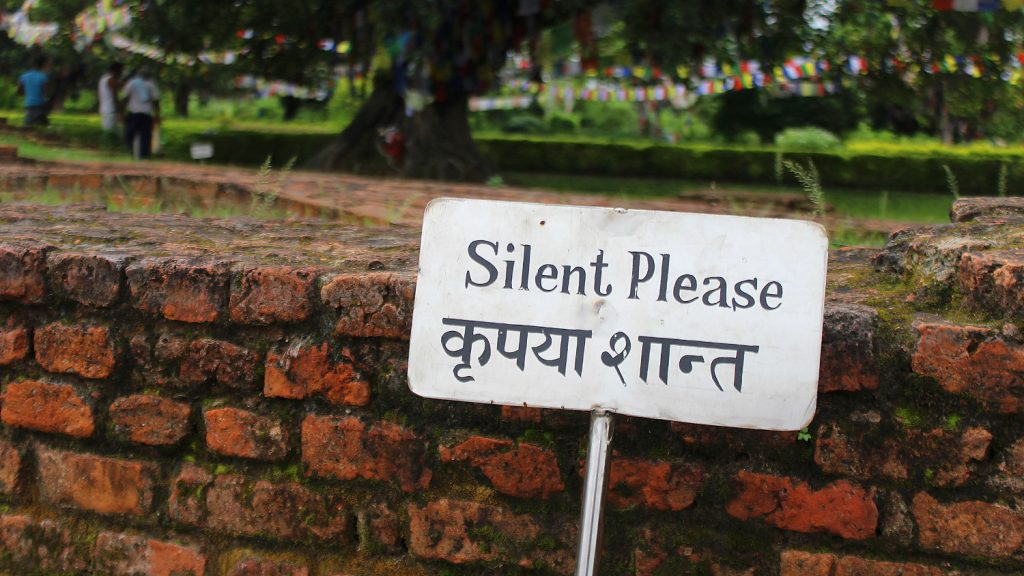 "A sign near the birthplace of Buddha saying ""Silence Please""."