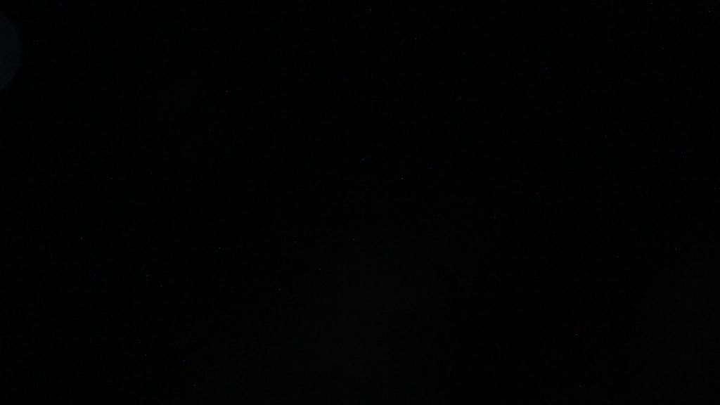A completely black picture. A failed photo of the sky full of stars.