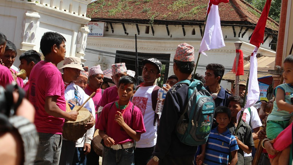 A traditional Hindu festival with people playing instruments in the center of Tansen Nepal.