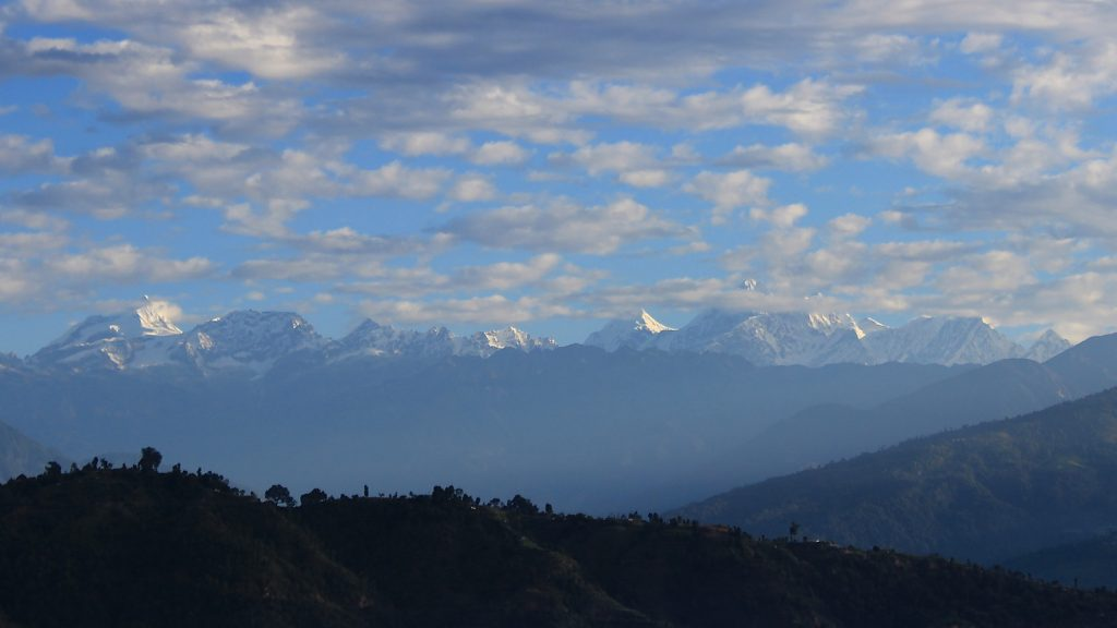 Clear view of the Himalayas in Nepalese countryside.