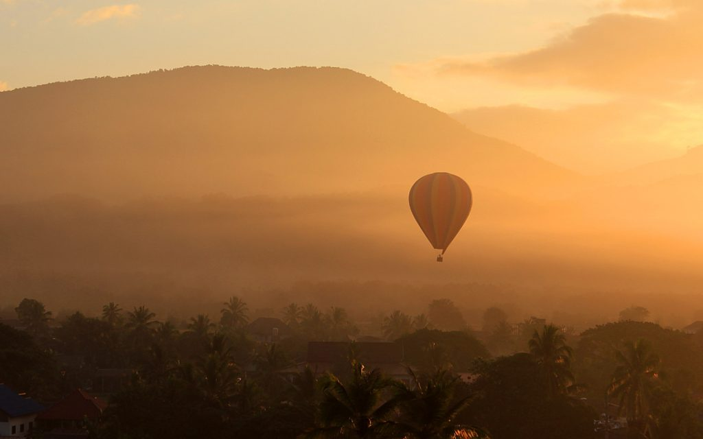 Hot air ballooning in Vang Vieng during the sunrise.