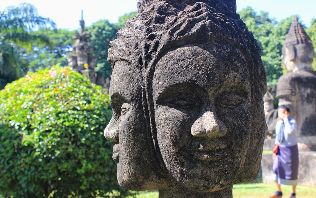 A four faced statue looking at all directions in Buddha Park.
