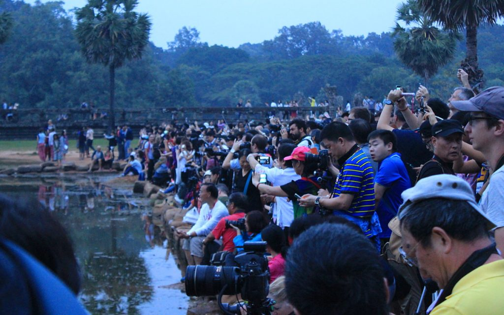 Tourist crowd waiting for sunrise at Angkor Wat.