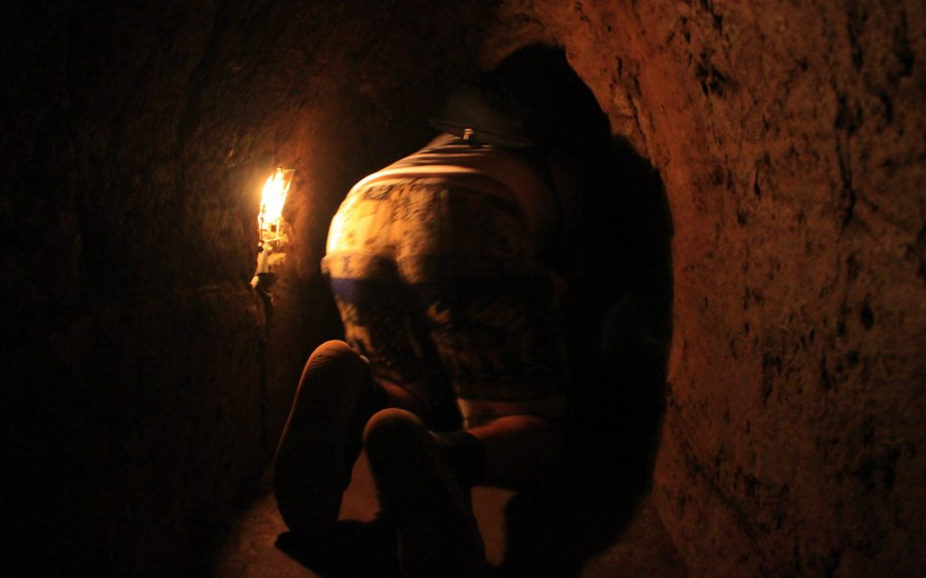 Crawling inside the Cu Chi tunnels.