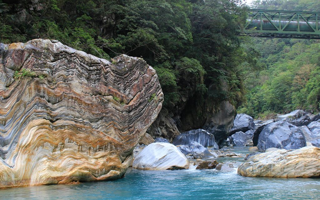Marble stones and crystal blue river in Taroko National Park.
