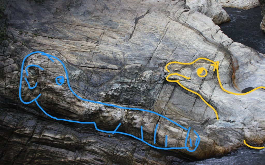 Rock formations of an elephant and a camel highlighted.