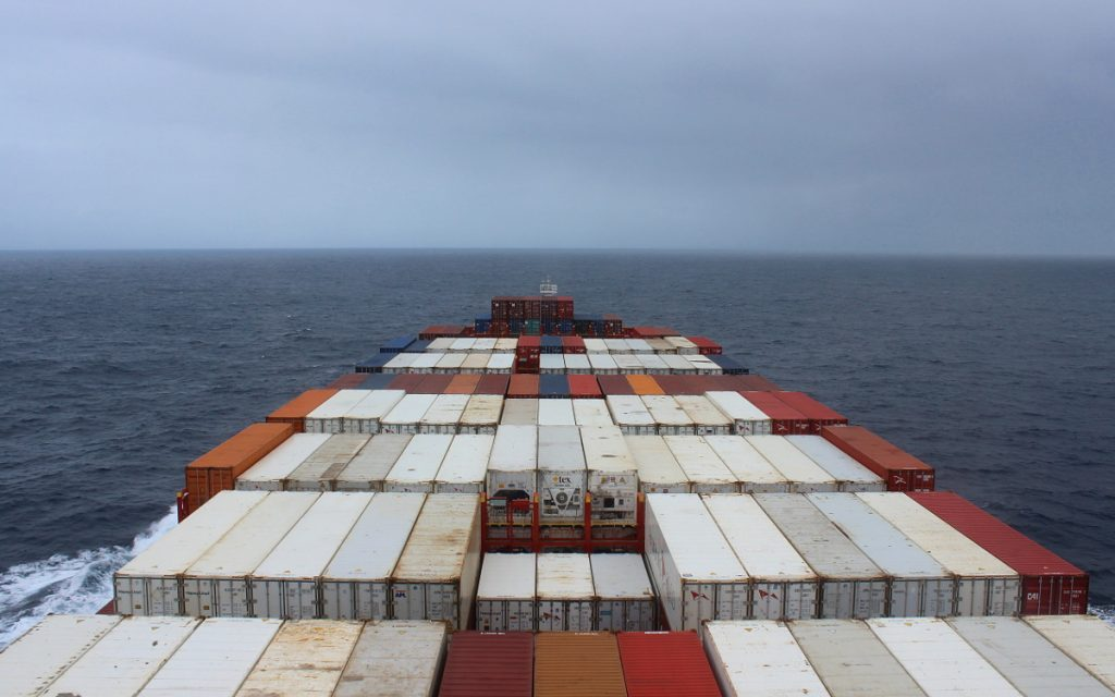 A cargo ship surrounded by grey clouds.