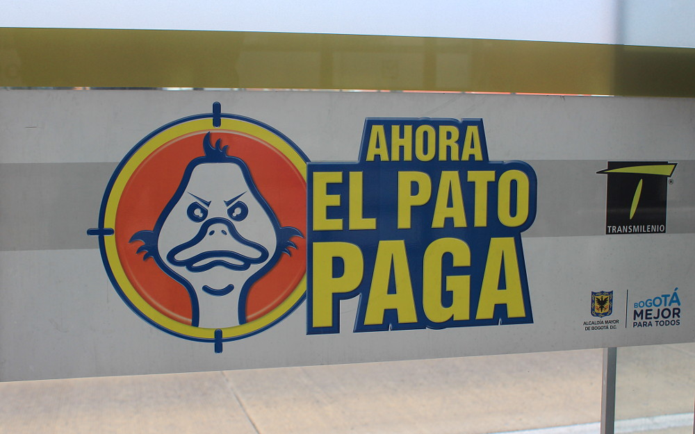 Ahora El Pato Paga sign on TransMilenio Rapid Transport System, Bogotá. Curious things about Colombia.