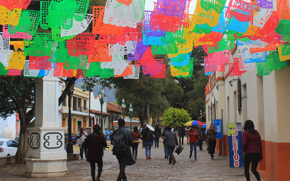Papel Picado paper cuts in San Cristobal de Las Casas, Mexico. A guide to overland public transport in Mexico.