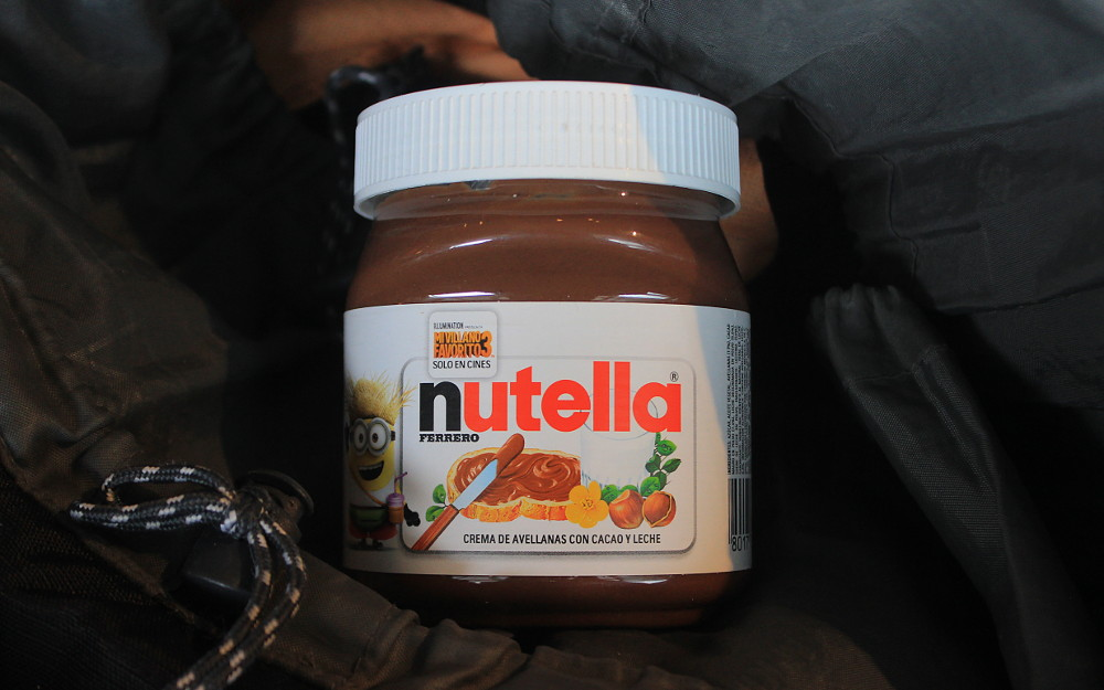 Nutella backpacker. a jar of Nutella in a backpack.
