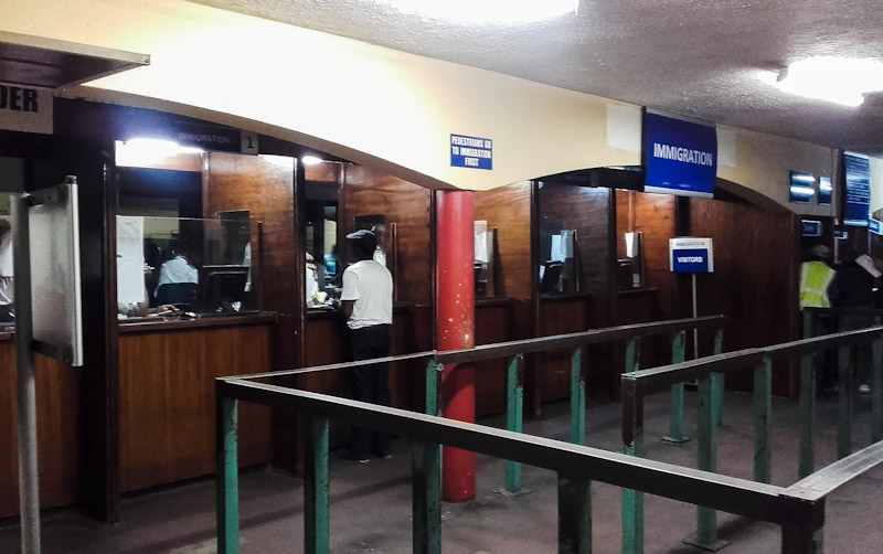 Getting a Visa on Arrival at Beitbridge border crossing while traveling on Greyhound public transport.