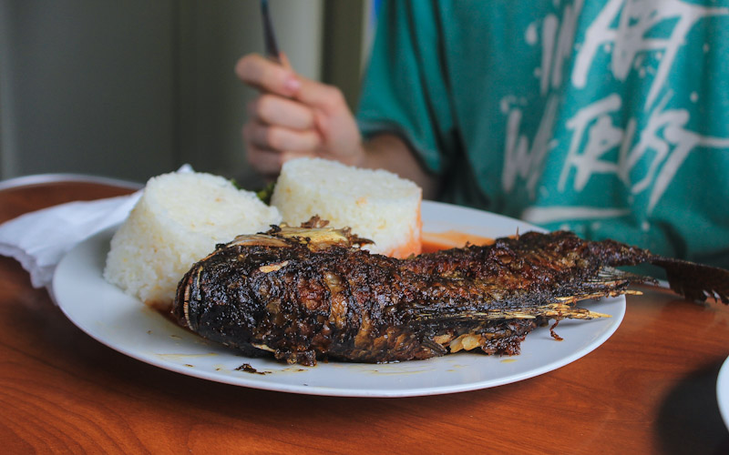Grilled fish and rice on a train restaurant car from Kapiri Mposhi to Dar es Salaam.