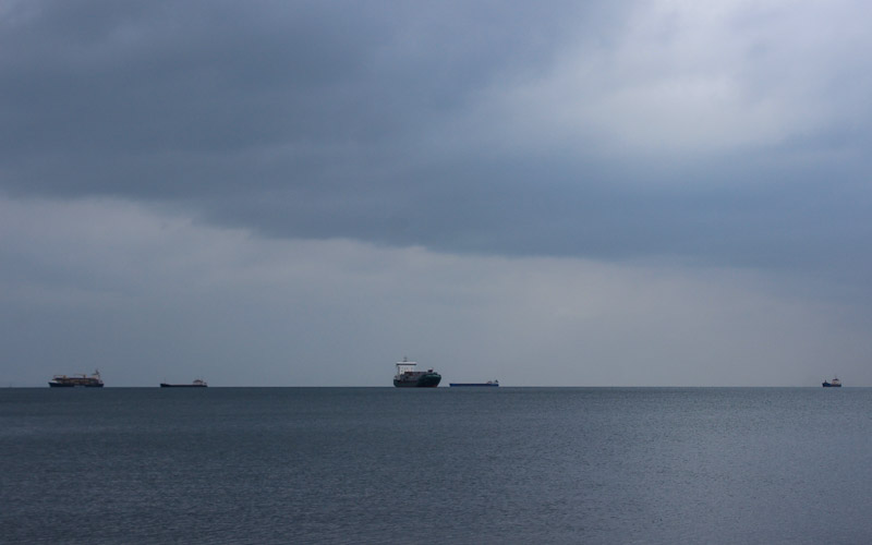 Cargo ships outside Thessaloniki on the horizon