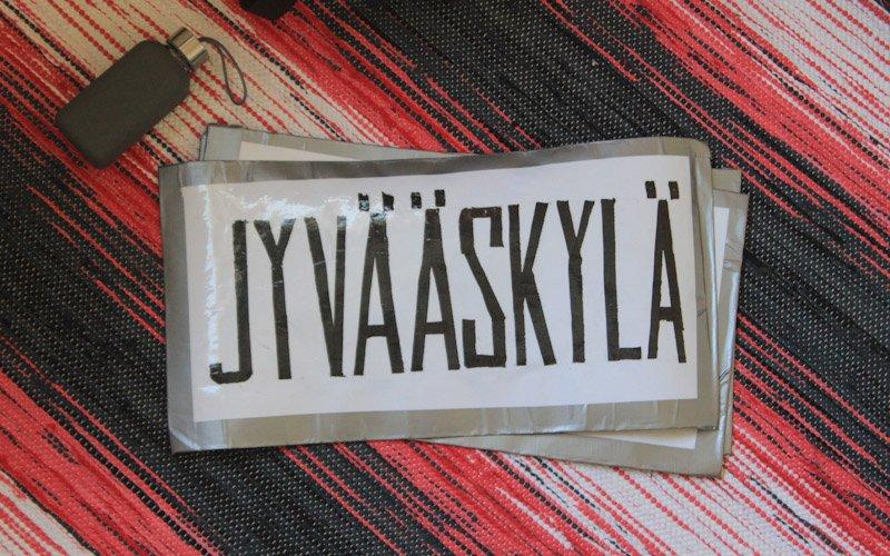 Hitchhiking in Jyväskylä, Finland. Jyvääskylä sign.